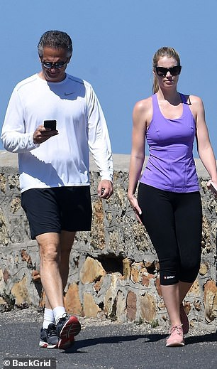 Kitty, who grew up in Cape Town, showed off her athletic figure in black cropped leggings, a purple fitted vests and trainers