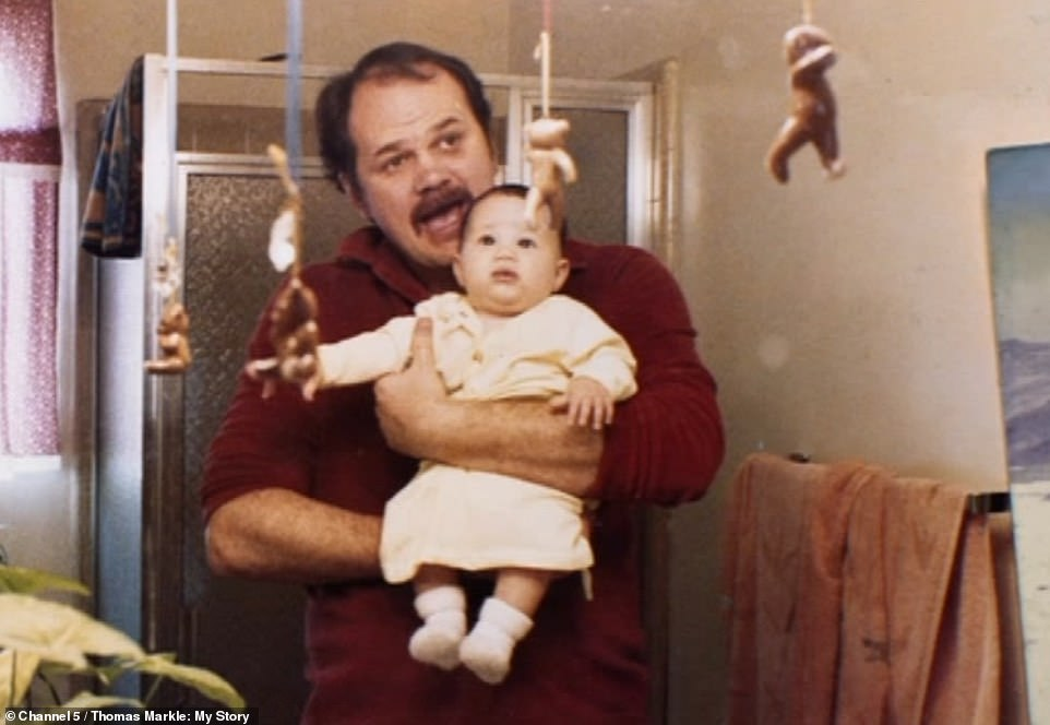 23764050-7919863-Thomas_holds_his_daughter_who_he_described_as_his_pride_and_joy_-a-132_1579774855342